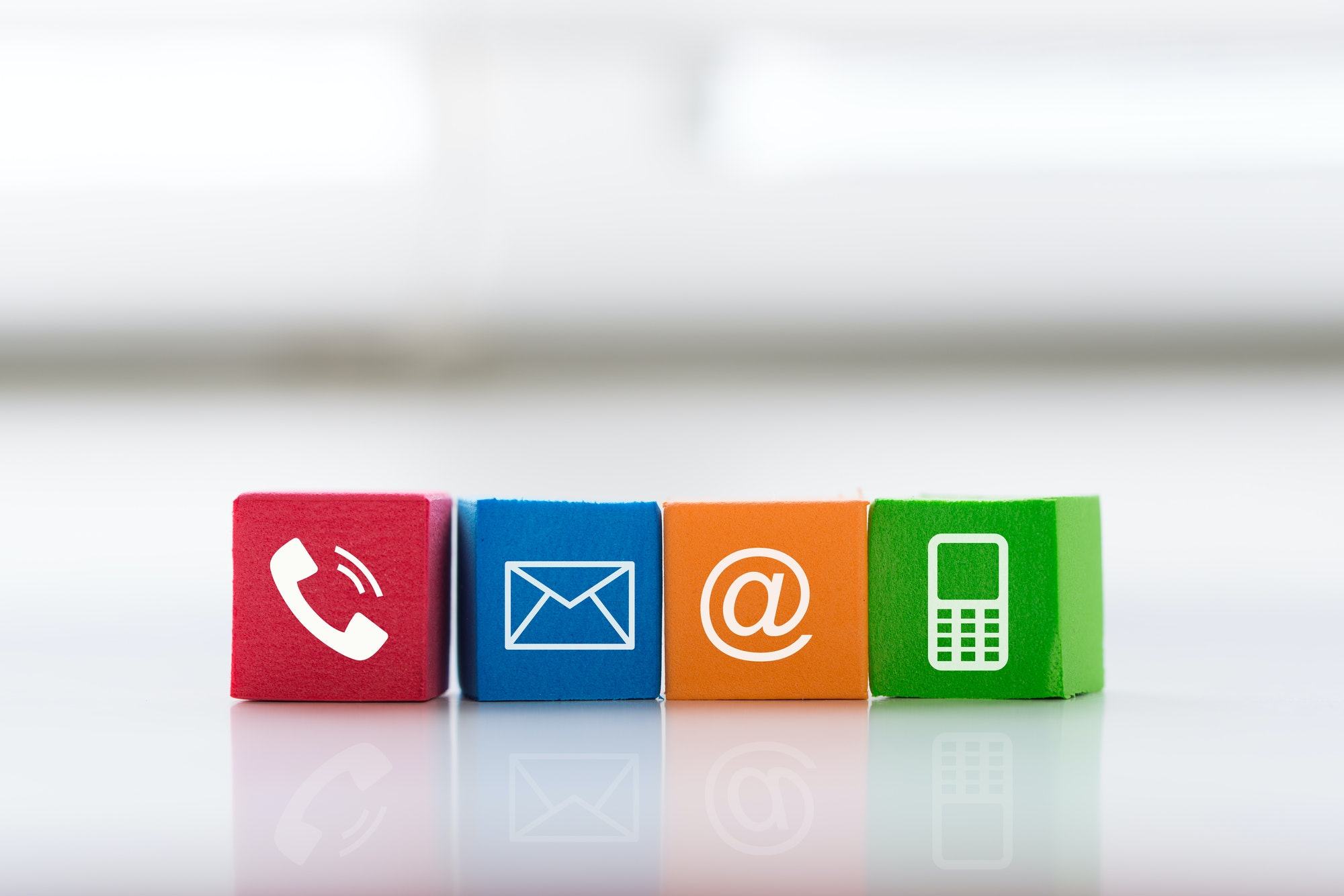 Contact us concept with colorful block symbol telephone, mail, address and mobile phone
